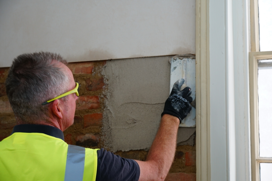 Applying sacrificial lime render